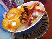 """YJ's Snack Bar128 W. 18th St, Kansas CityUrbanspoon score: 92YJ's has appeared on Food Network's """"Diners, Drive-Ins and Dives."""" It serves a Mexican brunch on weekends, but during the week it sticks to traditional breakfast, such as this plate of pancakes, eggs, bacon, potatoes and fruit."""