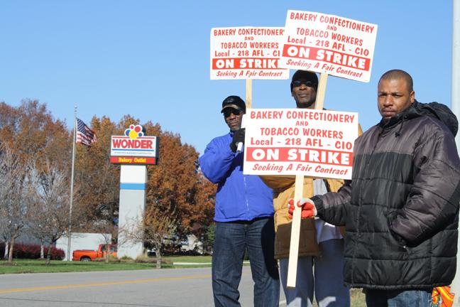Former Lenexa, Kan., Hostess employees and members of the Bakery, Confectionery, Tobacco Workers and Grain Millers International Union protest concessions the company made in bankruptcy.