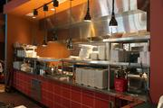 Mestizo features an open kitchen so customers can watch chefs at work.