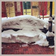 """@TravisSHolt tweeted this photo outside 10th and Wyandotte streets in Kansas City: """"@araletzKCBJ I think there's a car under there! #snowpics congrats on the wedding by the way! pic.twitter.com/Tjn2E8rpRf"""""""
