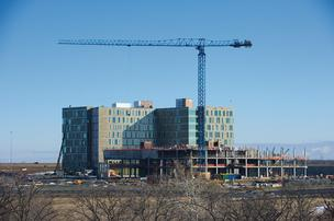 Work begins on the second tower on Cerner Corp.'s Continuous Campus even as construction continues on the first nine-story tower.