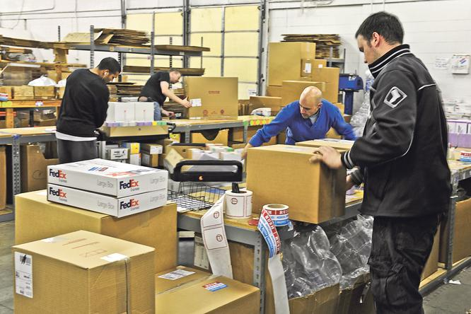 Suture Express workers fill orders that will be shipped out overnight throughout the country. The company's single distribution site allows it to stock thousands of supplies in bulk amounts, unlike its competitors.