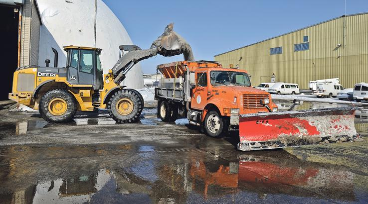 A snowplow gets a load of salt at the Kansas City Public Works facility north of Front Street and Chouteau Trafficway. The city's 1 percent earnings tax funds such general operations — and thus is a big factor weighed by various credit-rating agencies.