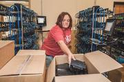 Adams Cable Equipment worker Jennifer Irwin boxes tested cable modems.