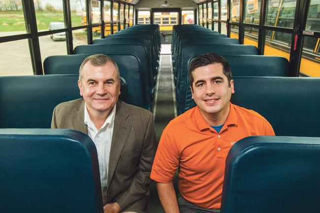 Mike Oyster (left), president of Apple Bus Co., and his son, Reid Oyster, operate an outsourcing bus company in four states.