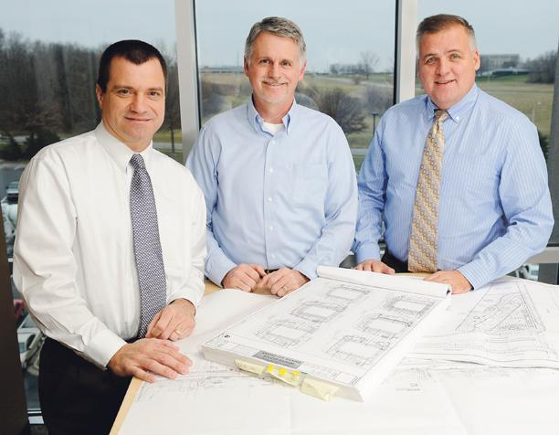 BHC Rhodes President Kevin Honomichl (from left), Executive Vice President Bill Brungardt and Vice President Matt Brungardt say a move to refocus on telecommunications and utilities work helped the Overland Park-based engineering firm increase revenue despite the recession.