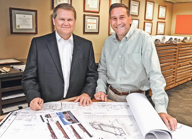 Chris Rhea (left) is president and Boyd Rau is senior vice president of BRR Architecture. Despite the recession, the firm has seen its employee numbers and billings increase steadily since 2009.