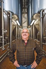 Mike Magoulas, CEO of Boulevard Brewing Co., says the company has added eight 300-barrel fermentation tanks to production (background).