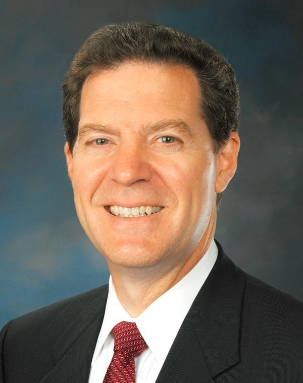 In his annual State of the State address, Kansas Gov. Sam Brownback said he plans to further reduce income taxes and extend a sales tax that would expire this summer.
