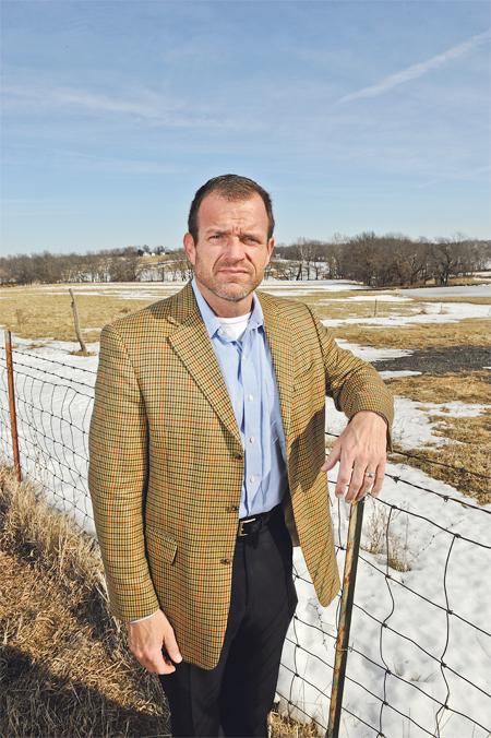 Chris Byrd, division chairman for governmental affairs for the Northland Regional Chamber of Commerce, stands on some of the 15,000 acres that will be developed in the Northland after infrastructure projects are completed. The work will include new highway interchanges and sewers.