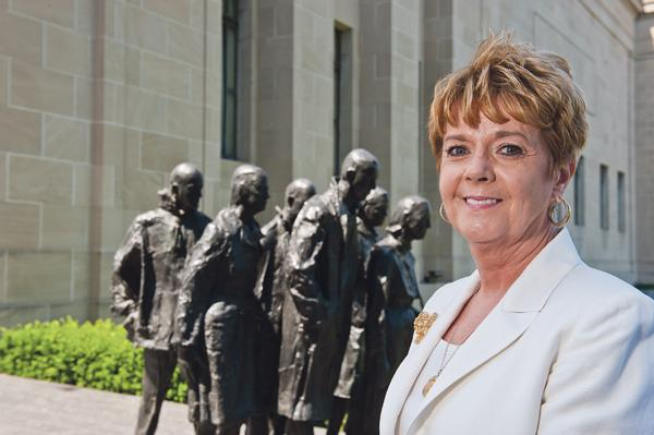 """Dorla Watkins, vice president for finance and administration of Park University, near """"Rush Hour"""" (George Segal)."""