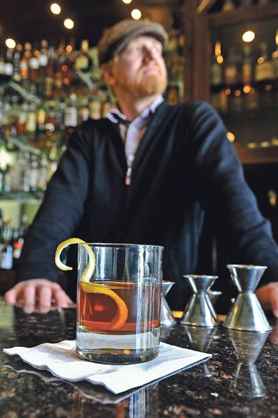 """Ryan Maybee, a partner at Manifesto — a bar beneath The Rieger Hotel Grill & Exchange — mixes cocktails such as the """"Pendergast"""" with Buffalo Trace bourbon, sweet vermouth, bitters and a touch of Benedictine."""