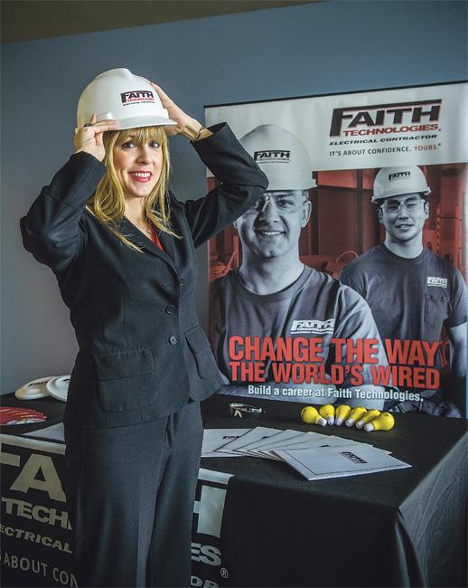 Stephanie Guin shows the props she uses to recruit construction workers at job fairs for Faith Technologies.