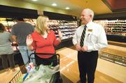 Beth Buchanan chats with Steve Haney, store director at Consentino's Market Downtown. The 35,000-square-foot store is a blessing, one official says.