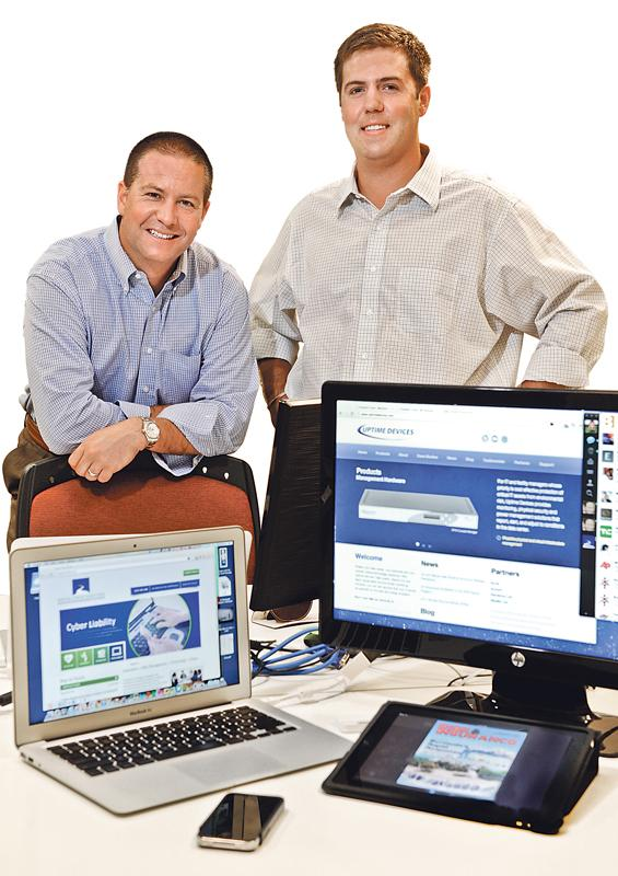 Tripp Miller (left) and Travis Holt are the owners of Brush Creek Partners, an insurance agency that specializes in cyber liability.