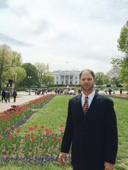 Mike Farmer, CEO of Leap2 LLC, stands in front of the White House just before the signing of the JOBS Act.