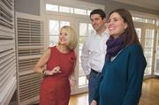 Realtor Gail Dicus, who had a heart transplant in 2005, talks with clients Matt and Kate Gibbs, who just bought a house in Mission and are expecting their first child in June.