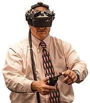 Greg Highbarger, a principal at ACI/Boland, demonstrates the 3-D goggles.