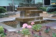 The trickling of a water fountain at a garden in North Kansas City Hospital helps mask the hum of the world outside this peaceful oasis.