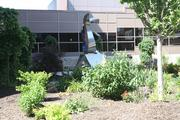 A rooftop garden at Saint Luke's Health System was planted by a group of employees led by volunteer Master Gardeners. A sculpture in the middle of the garden space was designed by local artist Kar Woo.