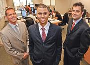 Major Baisden (center), president of Iris Data Services, is flanked by TJ Collins (left), director of operations, and Bryan Allen, senior technical engineer. Olathe-based Iris Data Services ranks 362nd on the new Inc. 500 list of fastest-growing companies. Between 2007 and 2010, its revenue grew 940.2 percent to $9.6 million.