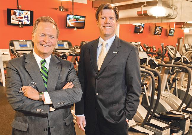 Rick Beyer (left), manager of human resources for JE Dunn Construction, and Steve Best, vice president of compensation and benefits, have seen rising participation in wellness plans. How far JE Dunn can go with its plans, however, may depend on how the courts marry anti-discrimination laws with the wellness programs.
