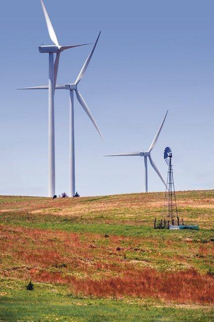 Wind turbines dwarf a traditional windmill along Interstate 70 between Salina and Hays.