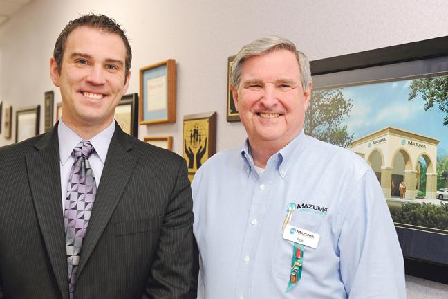 Brandon Michaels (left) became the CEO at Mazuma Credit Union when Rob Givens retired in 2011.