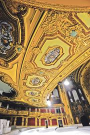 The Midland by AMC received historic tax credits in 2008 for its restoration, including gilded features on the ceiling below the theater's balcony.