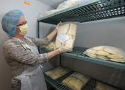 Registered Nurse Lissa Cross holds a frozen package of locally-donated human breast milk that will be homogenized and pasteurized at Saint Luke's Heart of America Mothers' Milk Bank.