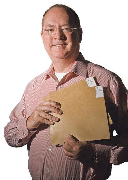 Ron Allen, president of Mobius105 Inc. and YFY Jupiter, holds paper for packaging purposes produced from rice and wheat straw.