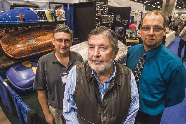 Don Sloan (center), owner of Polymeric Imaging Inc., is flanked by Rick Meeker (left), president of the car-top division, and company President Mike Plier at Polymeric's booth at the Kansas City Boat & Sportshow.