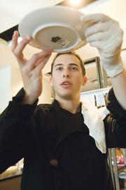 Chef Jeff Lefko eyes a prepared dish to make sure everything is perfect at Concept One, a recent pop-up.