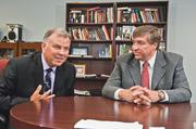 Kevin Truman (left), dean of UMKC's School of Computing and Engineering, and Timothy McDonald, dean of Rockhurst University's College of Arts & Sciences, talk about the schools' joint venture.