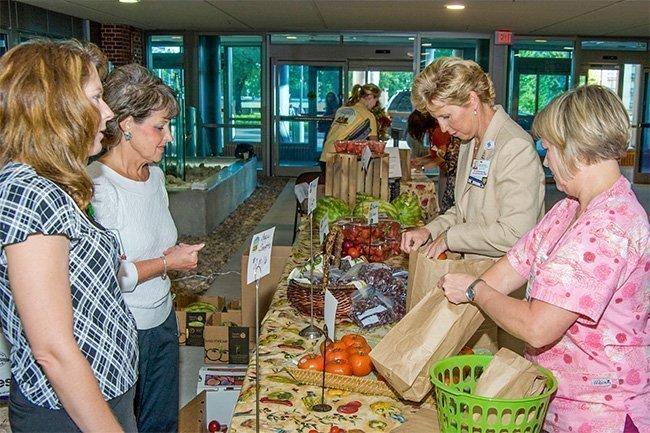 Saint Luke's Health System sponsors an employee-run farmers market to encourage healthy eating.