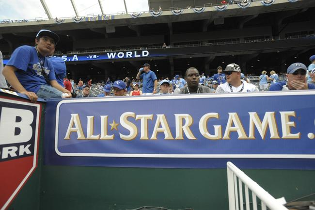 Fans wait for the action -- and possibly an autograph -- outside the first-base dugout at Kauffman Stadium.