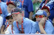 Young fans watch and wait for their baseball heroes before the start of the Home Run Derby.