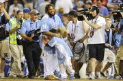 American League All-Star Prince Fielder of the Detroit Tigers is hugged by his sons Jaden and Haven after winning the Home Run Derby.