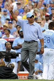 Baseball legend Reggie Jackson waves to the crowd at the Home Run Derby.