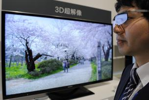 A Sony Corp. staff member wears 3- D glasses in front of the company's Bravia liquid-crystal-display television during an unveiling in Tokyo, Japan, on Friday, March. 23, 2012.