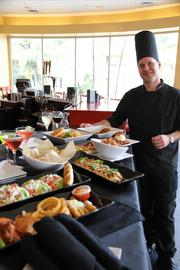 AMC executive chef Cory Shute with a selection of the Marina 6's new dine-in menu.