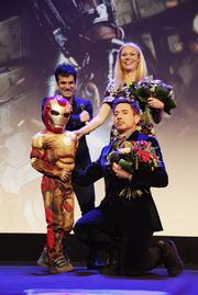 """Gwyneth Paltrow and Robert Downey Jr. posed with a mini superhero on the Paris leg of the world tour for """"Iron Man 3."""""""