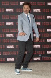 """Robert Downey Jr. struck a pose on the London leg of the world tour for """"Iron Man 3."""""""