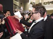 """Robert Downey Jr. signed autographs at a red-carpet fan event for """"Iron Man 3"""" at Time Square in Seoul last week."""