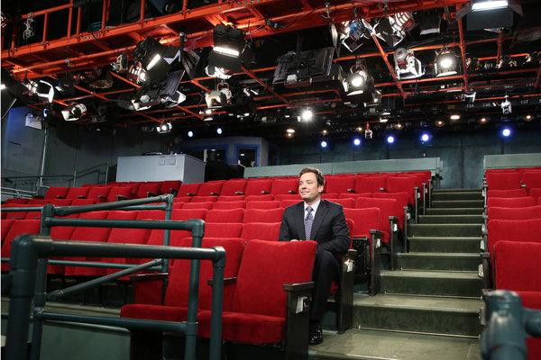 Jimmy Fallon sits in an empty audience during the taping of his show on Monday.