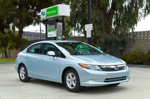 Honda is giving buyers of its 2012 Civic natural gas cars a debit card pre-loaded with $3,000 to buy natural gas fuel.