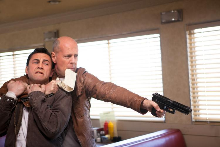 """""""Looper,"""" in which Joseph Gordon-Levitt and Bruce Willis play younger  and older versions of the same hit man, led overall disc and Blu-ray  sales as well as rentals last week."""