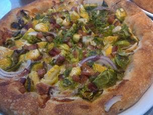 The pizza offerings at Milo & Olive include a brussels sprouts pizza with Mueske bacon.