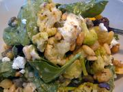 Marinated cauliflower with spinach, toasted pine nut, capers, golden raisins and goat cheese