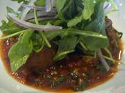 Free-range chicken meatballs in tomato sauce, with arugula and red onion